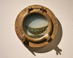 GREEN BOAT IN THE PORTHOLE