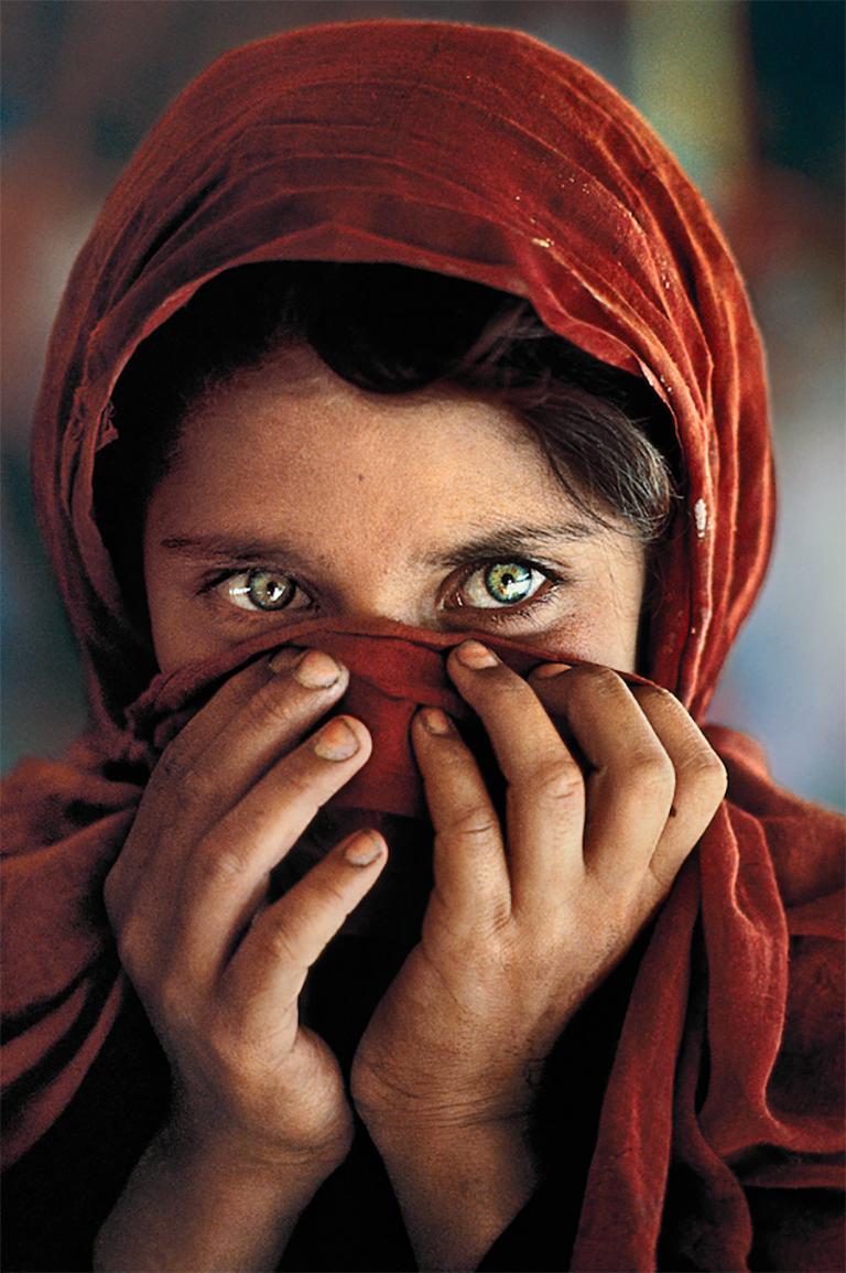 Afghan Girl Hiding Her Face, Peshawar, Pakistan, 1984 - Photograph by Steve McCurry