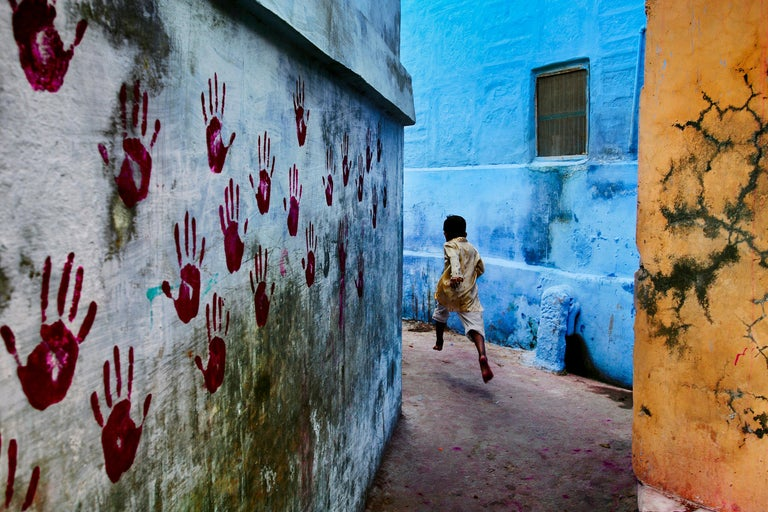 Steve McCurry Color Photograph - Boy In Mid-Flight, Jodhpur, India, 2007- Colour Photography