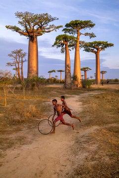 Steve McCurry 'Boys Play with Hoops'