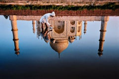 Man and Taj Reflection