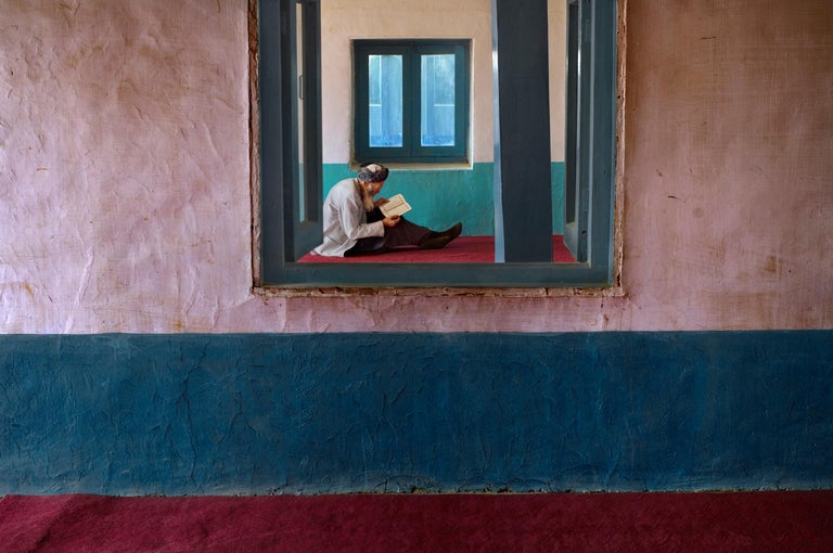 Steve McCurry Color Photograph - Man in Bamiyan Mosque, 2006