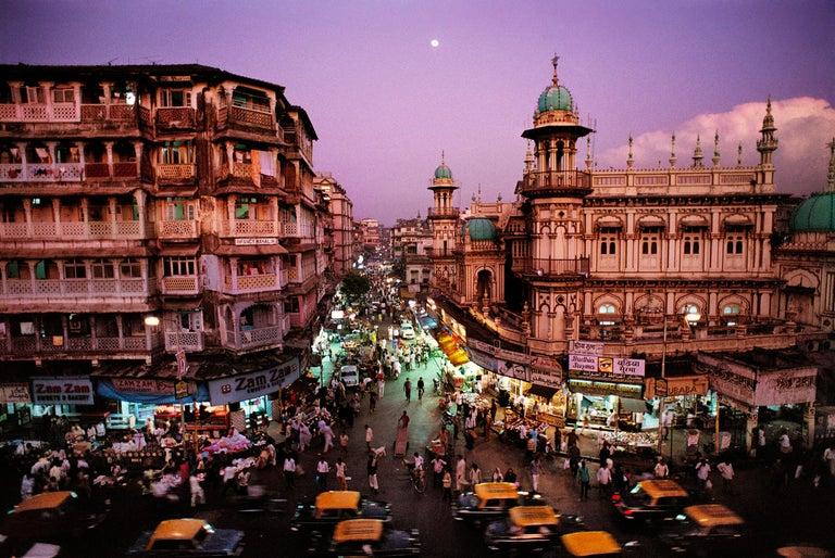 Steve McCurry Color Photograph - Moonrise in Mumbai