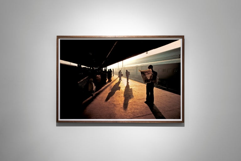 Train Station at Old Delhi, India, 1983 - Colour Photography - Black Color Photograph by Steve McCurry