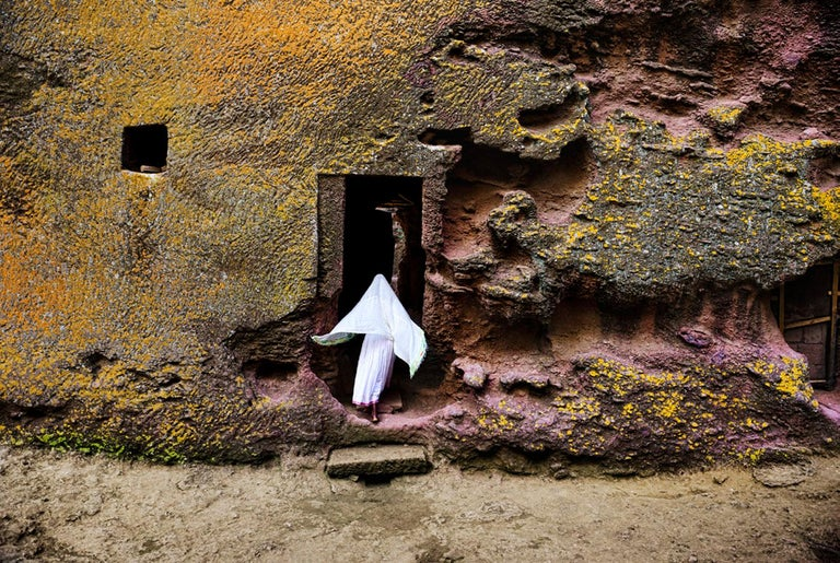 Steve McCurry 'Woman enters Medieval Rock-Hewn Church' - Photograph by Steve McCurry