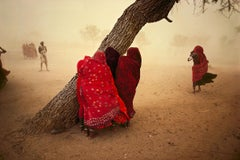 Women seek shelter from the dust storm, Rajasthan, India