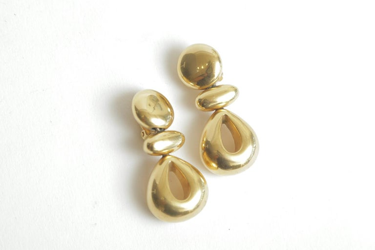 These stunning pair of gold plated signed Steven Vaubel pair of clip on earrings are very sculptural. These are from the 80's. They remain very modern today and very au courant. Their forms are somewhat organic meets modern. Their dangle is a