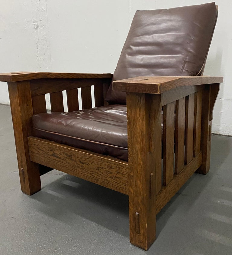 Arts & Crafts Mission oak and leather armchair by Stickley, circa 1920  Measures: 33.75