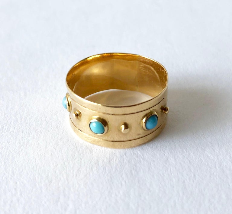 Rare, 18K gold studded ring with Persian turquoise cabochons created by Stig Engelbert of Sweden.  Ateljé Stigbert was founded in the early 1940's and produced Swedish modernist jewelry.  Ring is a finger size 7 and is 3.8