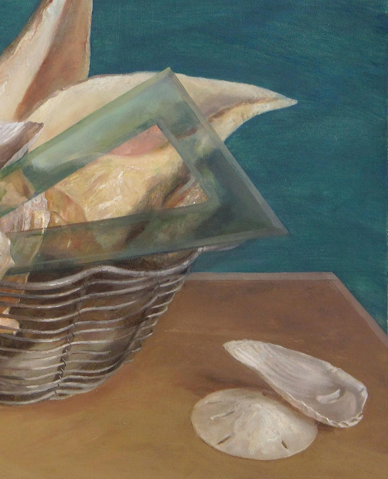 A silver wired basket holds several large seashells as well as various architectural tools. The varied textures, shapes and colors of the objects are rendered with careful detail, from the pale pink pearled interior of the conch shell to the