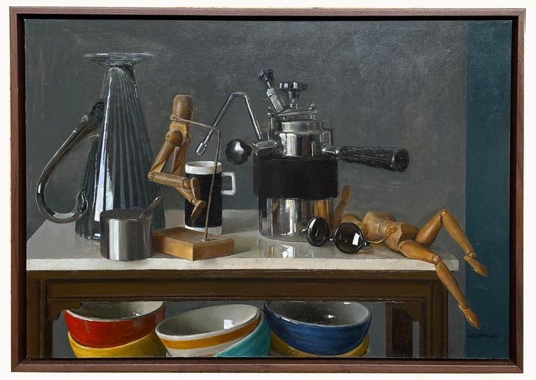 This still life painting on panel captures a variety of objects. Among the objects depicted are a elaborate Italian espresso maker, an upturned venetian glass pitcher, two wooden models and several colorful ceramic bowls. These masterfully painted