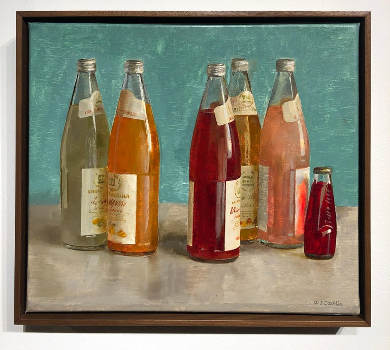 Still Life painting, with origins dating back to the 16th Century, often depicts simple everyday objects. Conklin uses richly colored Italian Soda bottles to play with placement and composition. Set on a gray table, the rich reds and corals of the