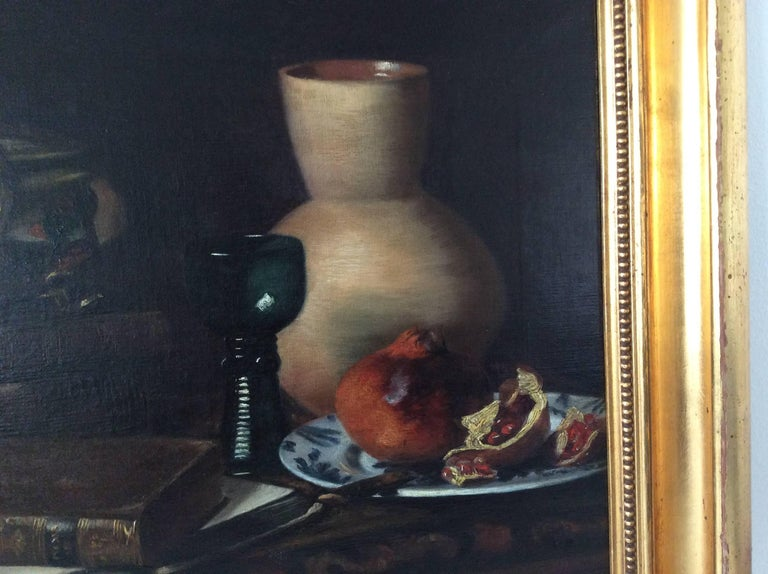 A still-life with pomegranate, jug and glass etc