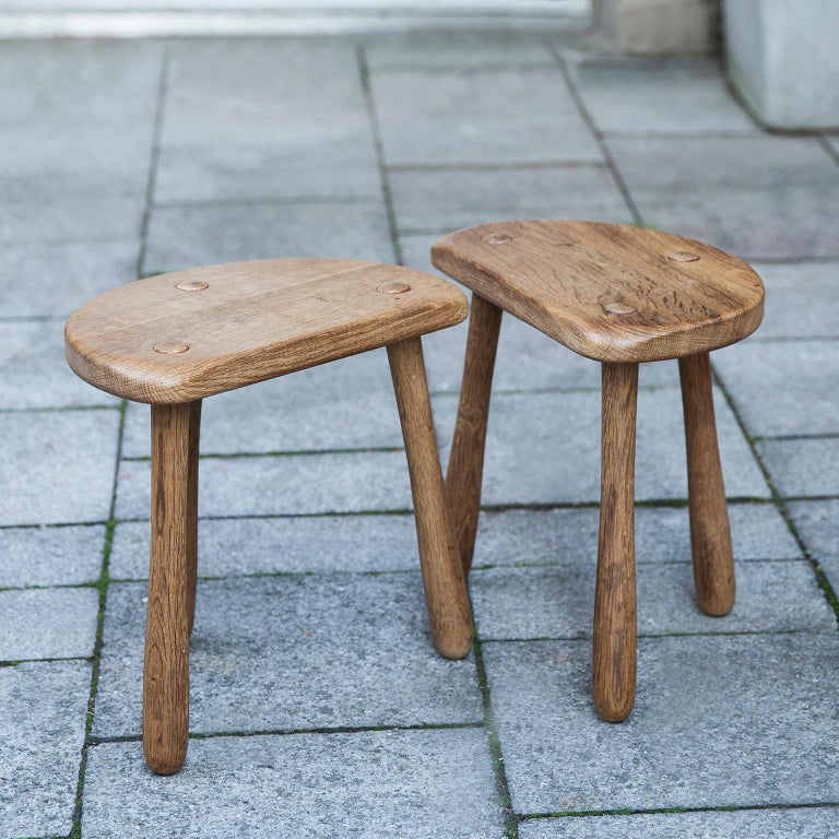 Fantastic clear design of 2 oak stools in solid oak from Denmark, 1930s. Signed with branded manufacturer's mark to underside [Stilmobler]. Measures: 23.5 D x 37 W x 36 H cm.