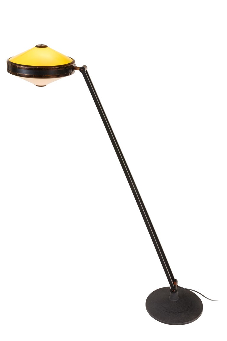 An extremely versatile and distinctive design. The base adjusts both forward and backward allowing for a variety of positions. The head of the lamp also rotates to give you the choice of white or yellow light in either direction.