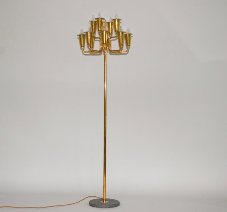 Stilnovo Italian brass floor lamp designed by Sciolari for this prestigious brand in the 1950s. This impressive lamp has a solid brass frame and has a solid marble base. The lamp has been newly re-wired using gold silk cable. A very striking item.