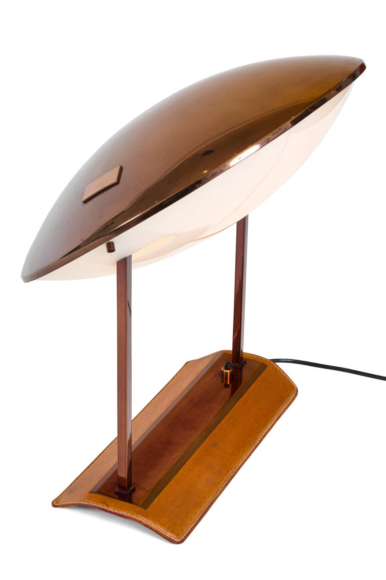 A rare lamp by Stilnovo that pivots forward or backward and has a lovely leather base.