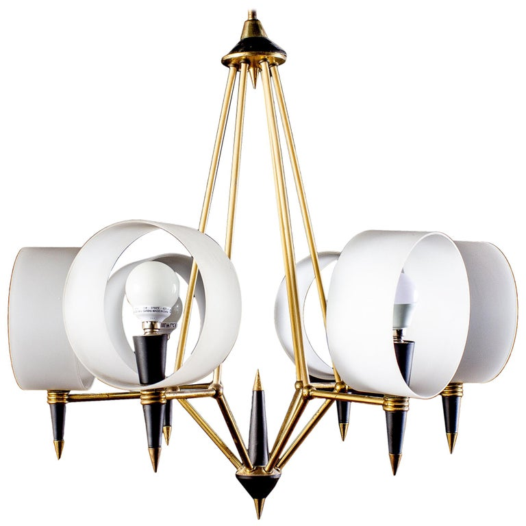 Linear elegance, brass and black painted six arms chandelier, holding round opaline glass shades. Excellent vintage condition.