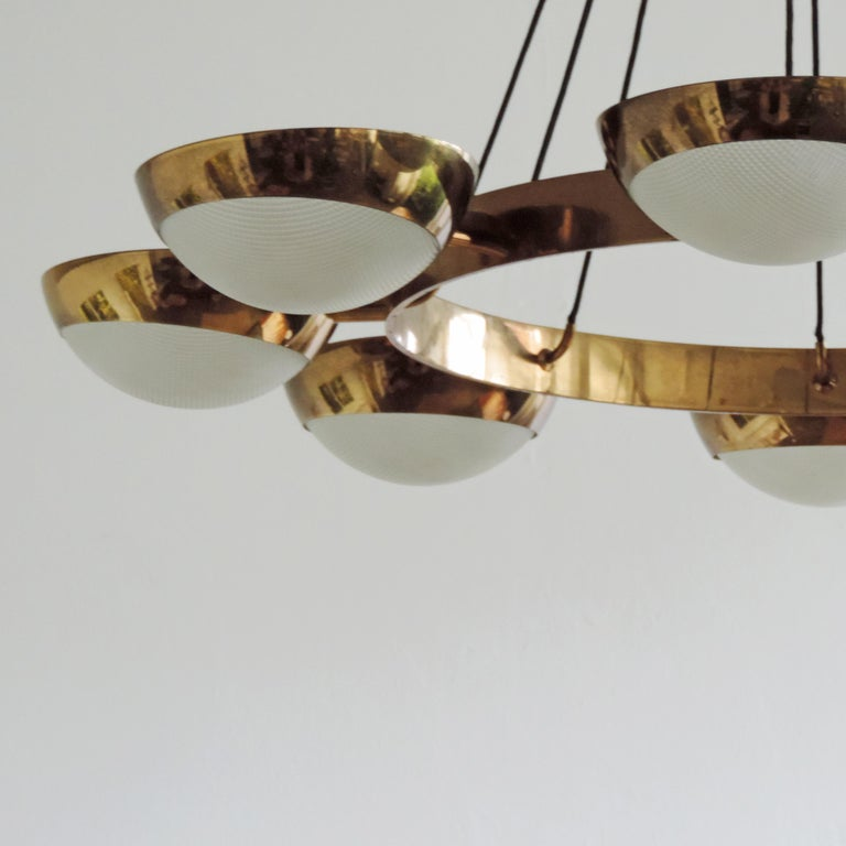 Monumental and rare Stilnovo ceiling lamp in beautiful patina and with its original electrical wiring and glass cups. The Stilnovo ceiling lamp retains the original Stilnovo label.