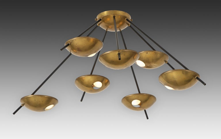 Stilnovo original ceiling or wall light model 1036, Italy, 1950s. 7-light fixture with brass shades on black enameled metal arms of different lengths radiating from central canopy or mount. In original condition with beautifully patinated brass