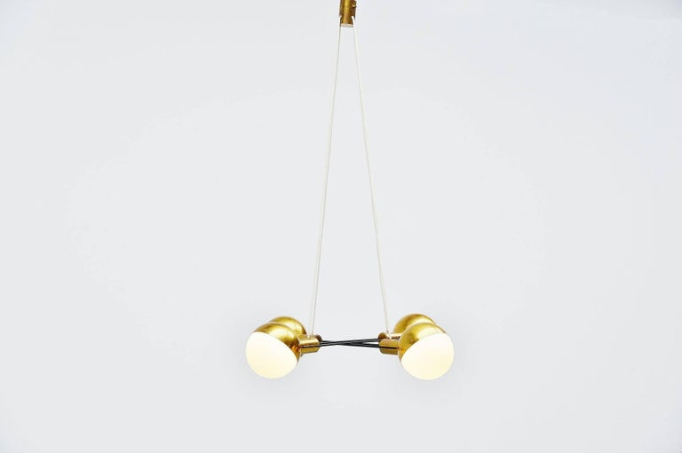 Very nice and impressive large chandelier designed and manufactured by Stilnovo, Italy 1960. This is for a very nice modernist shaped chandelier with brass shades and milk glass diffuser shades attached with the typical Stilnovo screws. Black