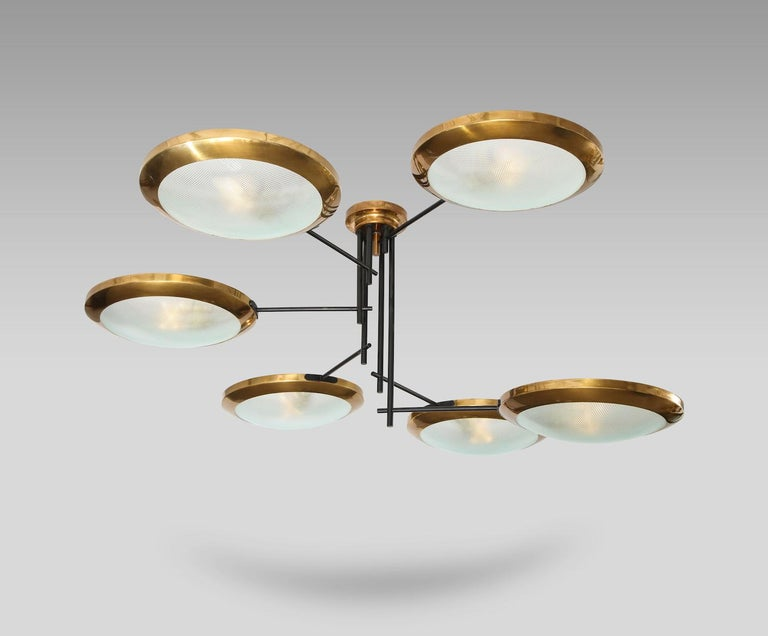 Rare 6-arm chandelier by Stilnovo. Black-painted metal rods, polished brass frames and textured glass diffusers. Each of the 6 arms ends with one standard size Edison socket.