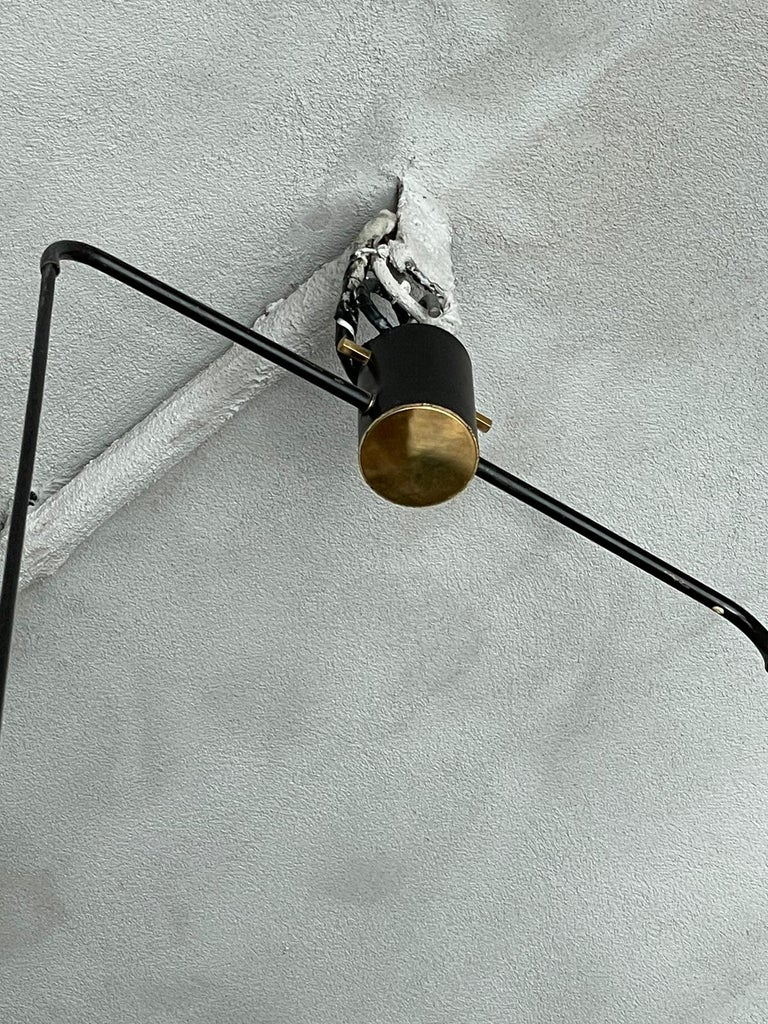 Chandelier manufactured by Stilnovo in Italy, 1950s. The chandelier consists of two cylindrical white and black lamellar diffusers.  Inside the chandelier there is a diffuser of white opaline conical glass and outside there is a cylindrical