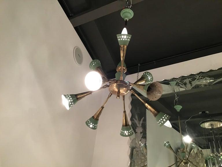 Stilnovo chandelier with 9 adjustable lights brass metal, 1955, Italy.