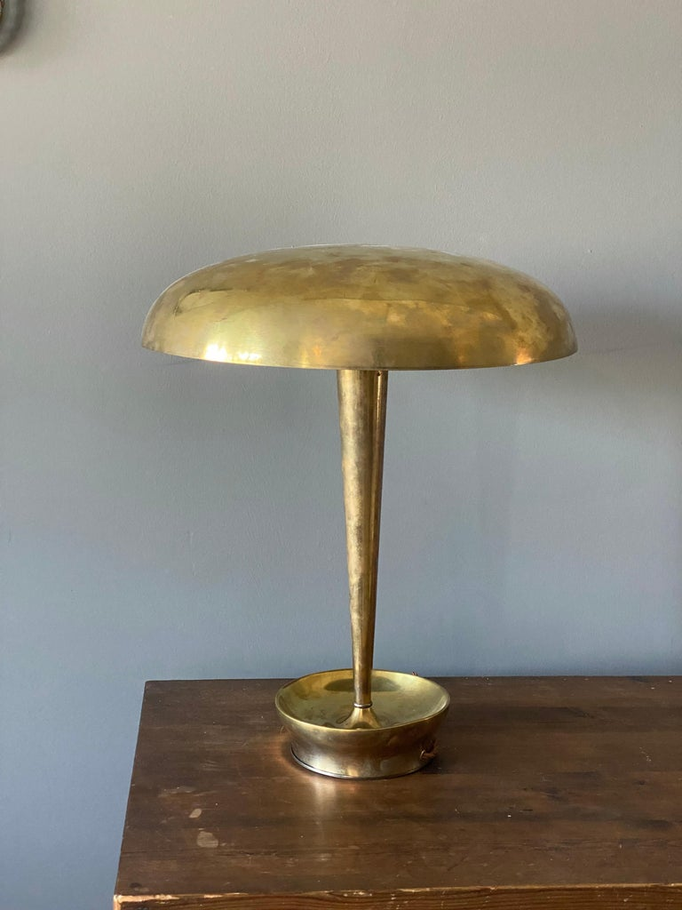 A table lamp / desk lamp produced by Stilnovo, Italy. Produced in brass, chromium-plated metal, and opaque glass.
