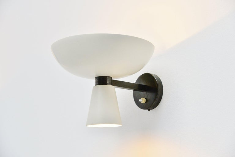 Italian pair of wall lamps with diabolo shades in white with patinated brass arms by Stilnovo, Italy 1950. These wall lamps have white lacquered shades, in fully original condition. The arm is made of dark grey patinated brass. Can be used both