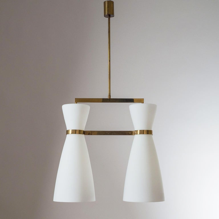 Rare modernist chandelier by Stilnovo from 1950s. Two very large (18inches/45cm) tapered satin glass diffusers are suspended by a minimal polished brass structure. Original brass and ceramic E27 socket with new wiring. Original Stilnovo label.