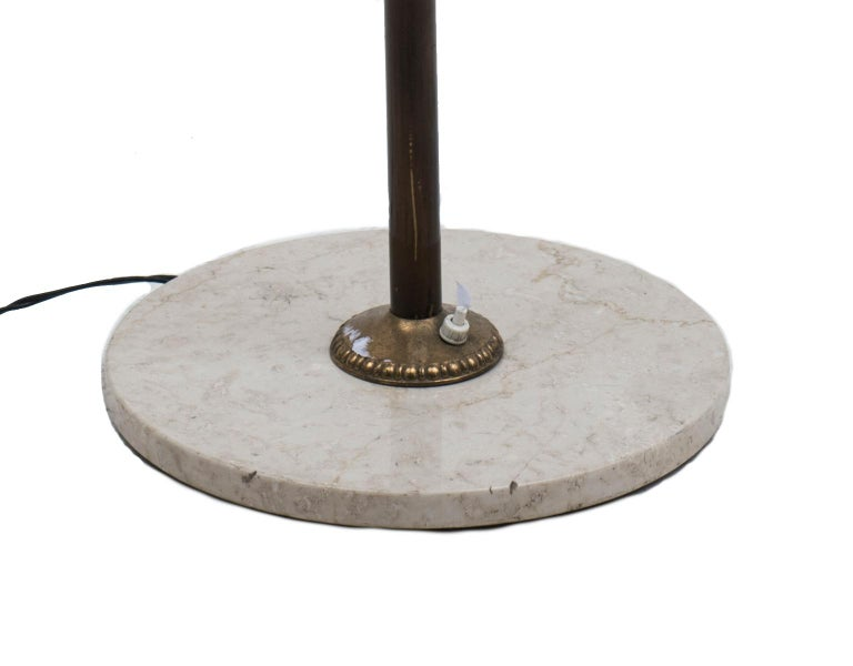 Floor lamp in brass and satin glass diffusers. Marble base.