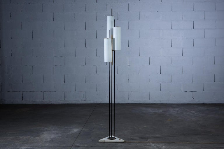 An elegant Stilnovo floor lamp from Italy in the 1950s. With a marble base, brass frame and three opaline glass cylinders. In good original vintage condition.  Dimensions: D: 34cm x W: 38cm x H: 177cm    UK customers please note: listed prices