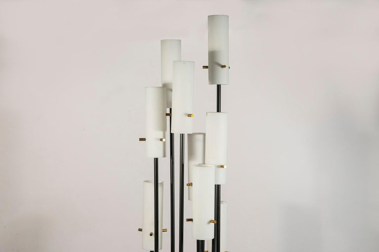 Stilnovo, Floor lamp with eight-light, Opaline lampshades, painted iron and golden brass, circa 1960, Italy.  Measures: Height 187 cm, diameter 31 cm.