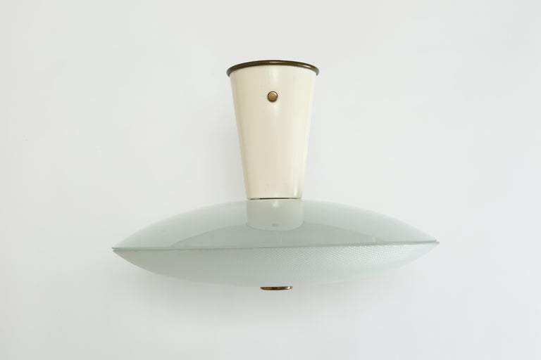 Stilnovo flush mount. Consists of two pieces of hand blown glass, enameled metal, brass. Stilnovo label.
