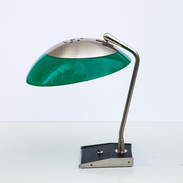 Stilnovo table or desk lamp with a black painted base and a white and green adjustable perspex shade. New wiring and plug, but the marked Stilnovo old plug is included.