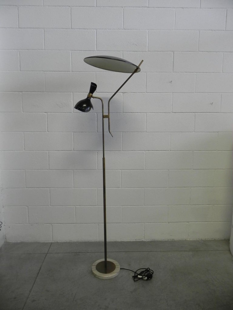 A rare Stilnovo adjustable floor lamp. Original painted metal shades with brass arms and a marble base.