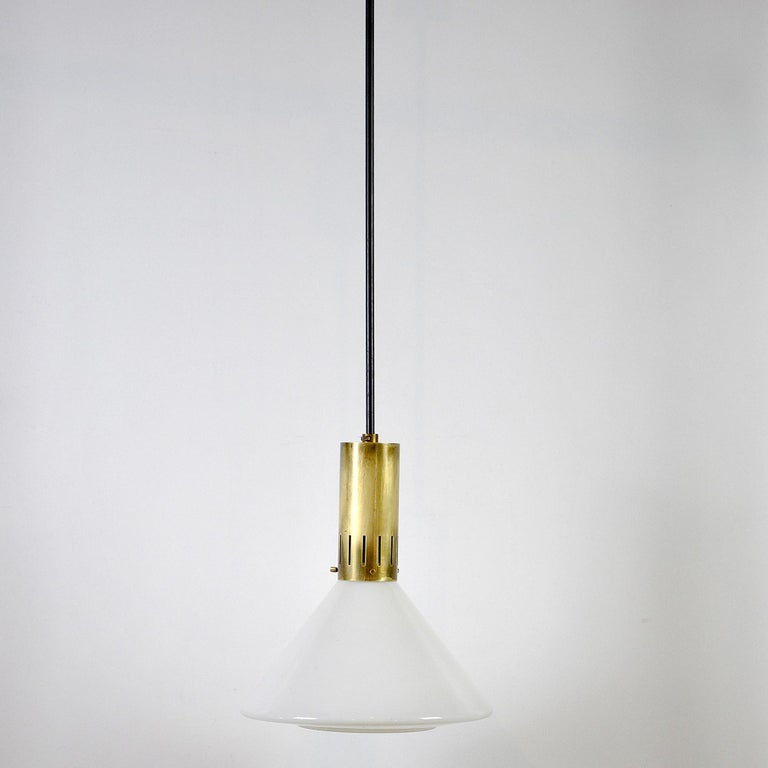 Suspension of Italian production by Stilnovo, structure in brass and opaline glass, datable to the early 1960s.