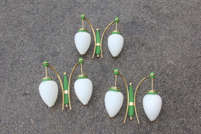 Stilnovo Style Italian sconces green color gold white original design, circa 1958.  Each sconce mounts two bulbs E14 max 40 Watt each.