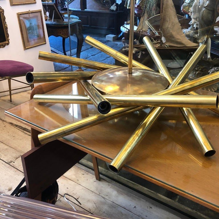 A Sputnik chandelier made in Italy in the 1950s by Stilnovo, brass has been cleaned but maintain his vibrant vintage look, original wiring, triple type of lighting, 8-light up, eight-light down and all together. It works 110-240 volts and need 16