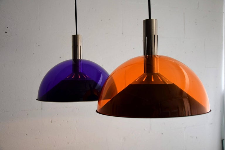 Mid-Century Modern Stilnovo ceiling lamp made of an orange and purple acrylic shade icm with teakwood, stainless steel and black painted iron. The shades can be adjusted separately in height. The lamp will be shipped in a custom made wooden crate.