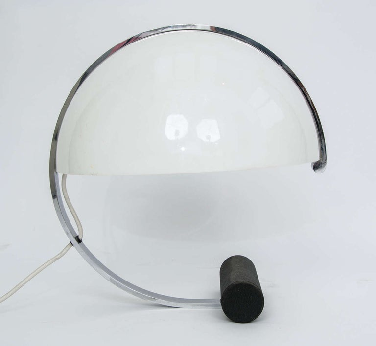 1970s table lamp with white acrylic shade, chrome frame and heavy black steel base. A high quality piece by Stilnovo of Italy for the Dutch distributor Artimeta. The white acrylic shade provides a nice diffuse light.  The lamp has been re-wired to