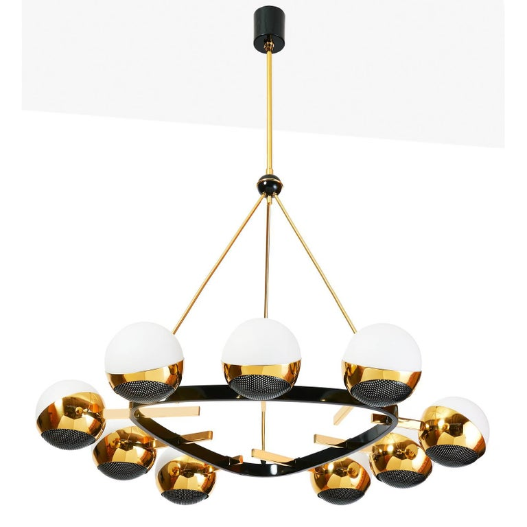 Stilnovo Nine branch rounded triangular chandelier by Stilnovo in polished and black enameled brass, with opaline glass globes set in polished brass mounts with black enameled perforated screens. Italy, 1950s Dimensions: 30 Diameter x 39 H as shown