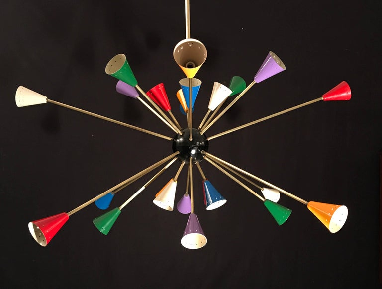 Features 24 brass arms, each sporting multicolored, perforated shades. Black central sphere.