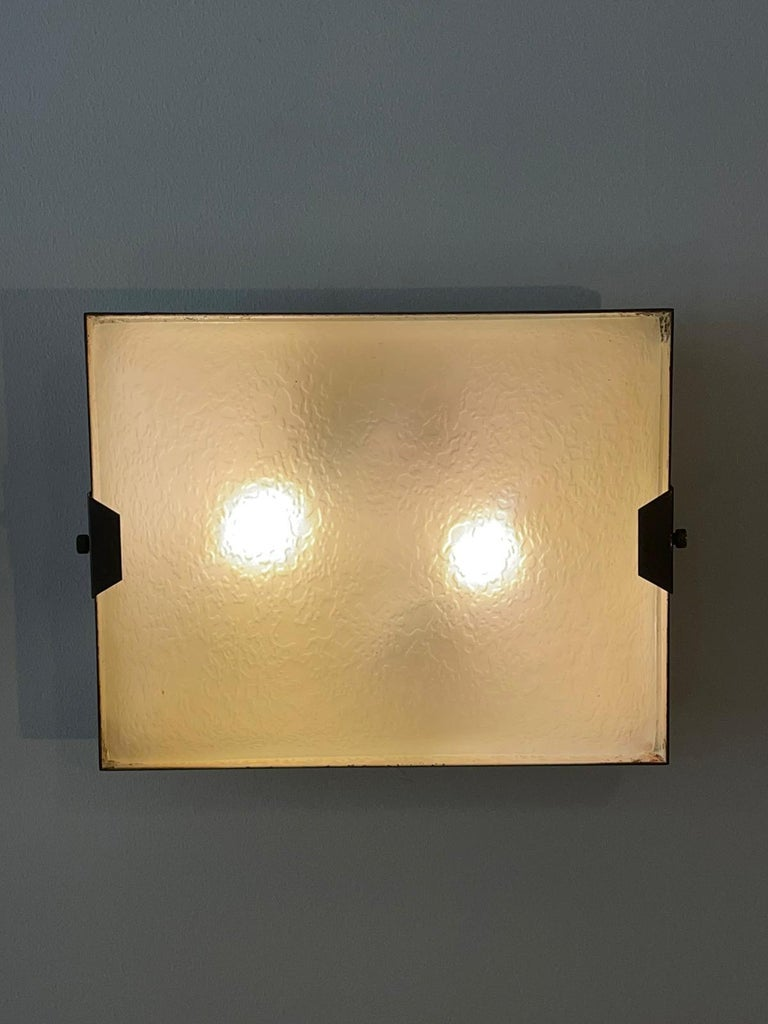 Pair of rectangular wall lamp manufactured by Stilnovo, Italy, 1950s White lacquered metal structure and frosted glass. In the back is present the stamp
