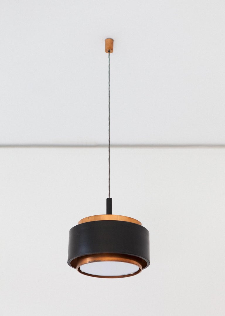 Mid-Century Modern pendant lamp, designed and manufactured in Italy by Stilnovo in the 1950s.
