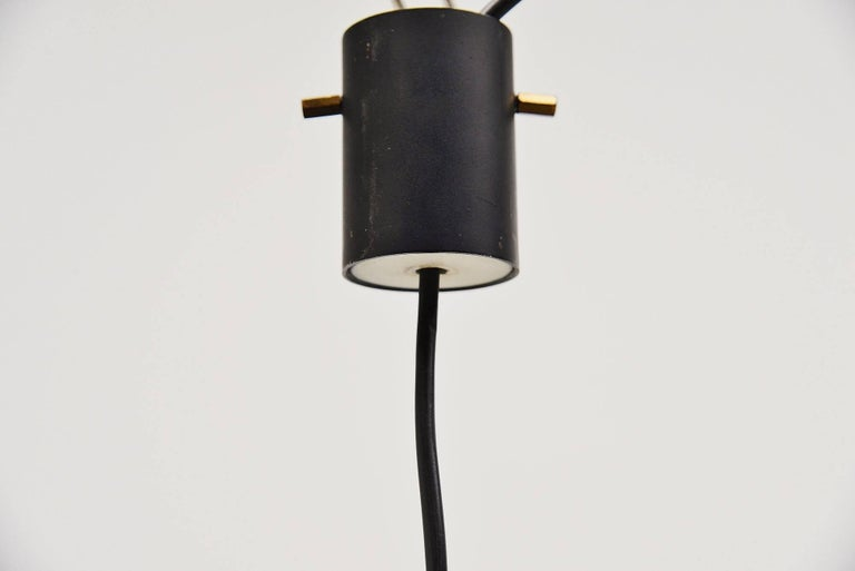 Nice pendant lamp model 1135 designed and made by Stilnovo, Italy 1960. This is for a very nice modernist shaped pendant lamp with a yellow lacquered metal shade holder, and a large white opaline glass diffuser shade. The lamp has a funny plexi