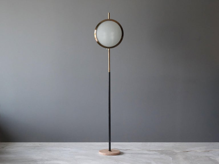 A rare modernist / Minimalist floor lamp produced by Stilnovo, Italy, 1950s. Features an interesting mix of marble, black lacquered metal, brass, and frosted glass.  Has a similar expression to that of floor lamps by Max Ingrand or Angelo