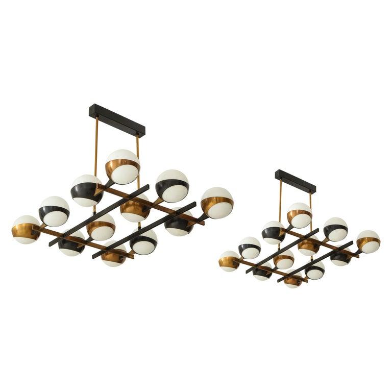 Stilnovo Rare Pair of Twelve-Light Chandeliers For Sale