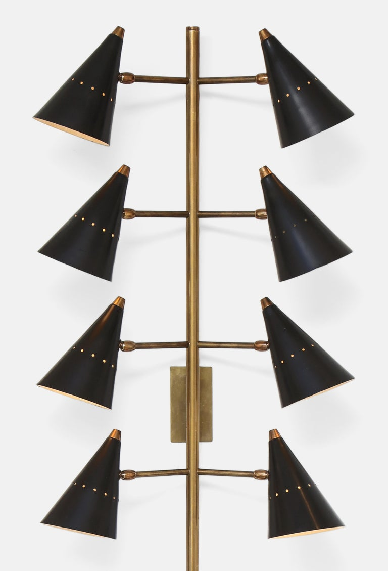 Stilnovo very rare and stunning pair of tall 8-light wall lights with articulating conical shades in black lacquered aluminum suspended on brass arms and mounted long stem. Stamped 'Stilnovo PATENT' on bottom of each brass stem, Italy, 1950s. Newly